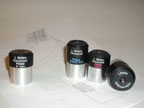 A collection of 11  eyepieces